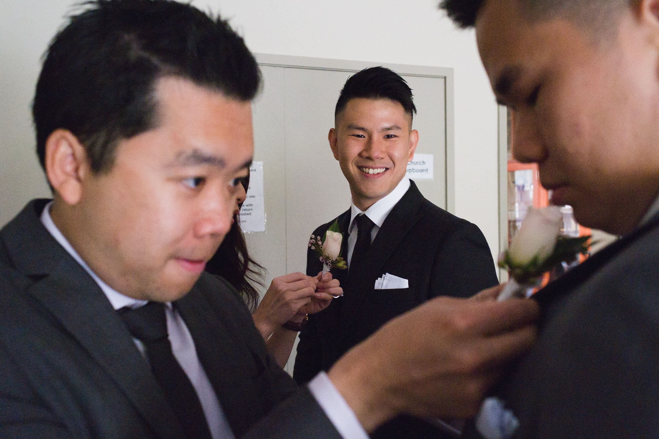 Lynsey and Kai's Melbourne wedding - Groom and groomsmen getting ready with boutonniere at wedding venue in Melbourne