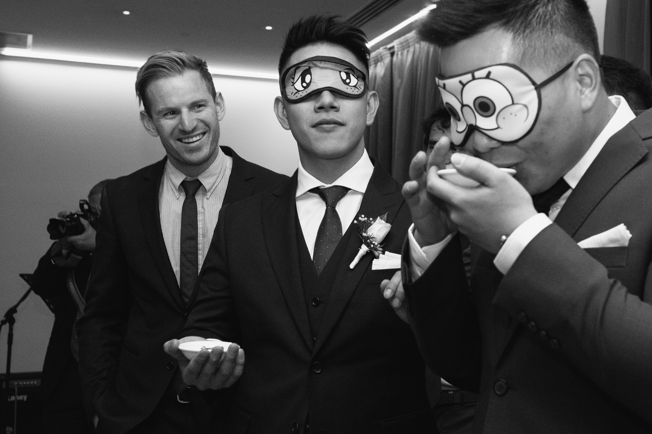 Lynsey and Kai's Melbourne wedding - blindfold wedding games at reception at the Marriott Hotel