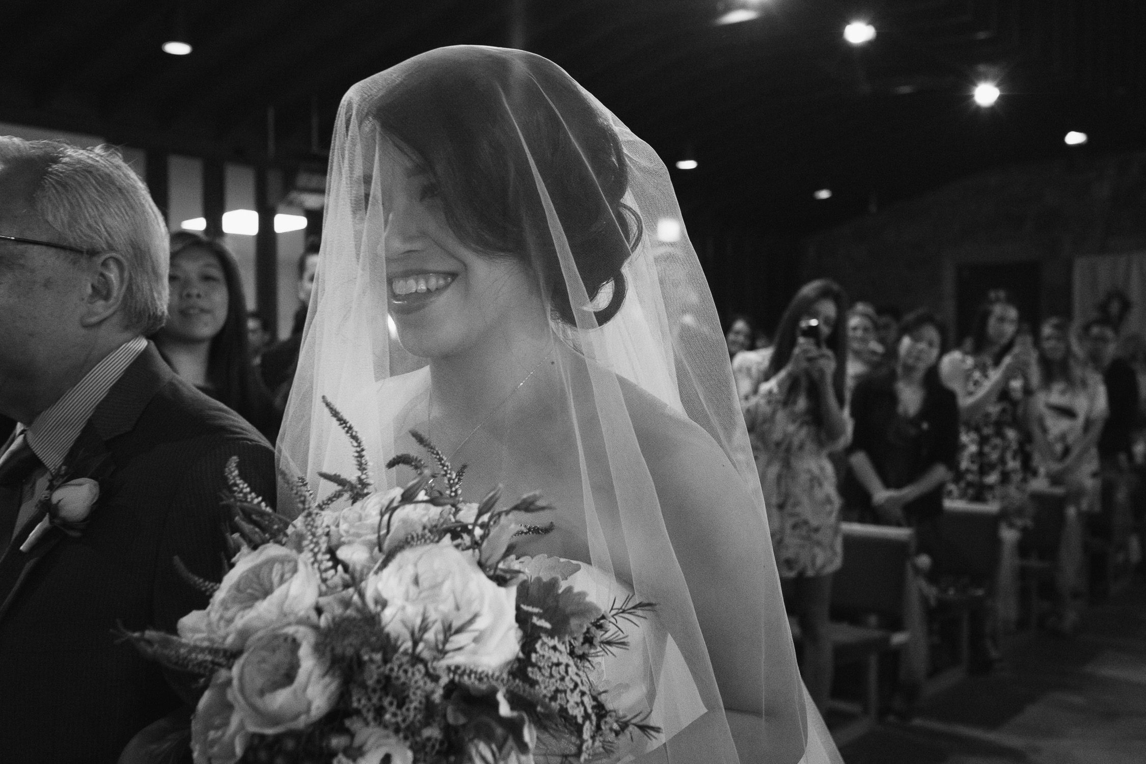 Lynsey and Kai's Melbourne wedding - bride walking down the aisle at church wedding venue
