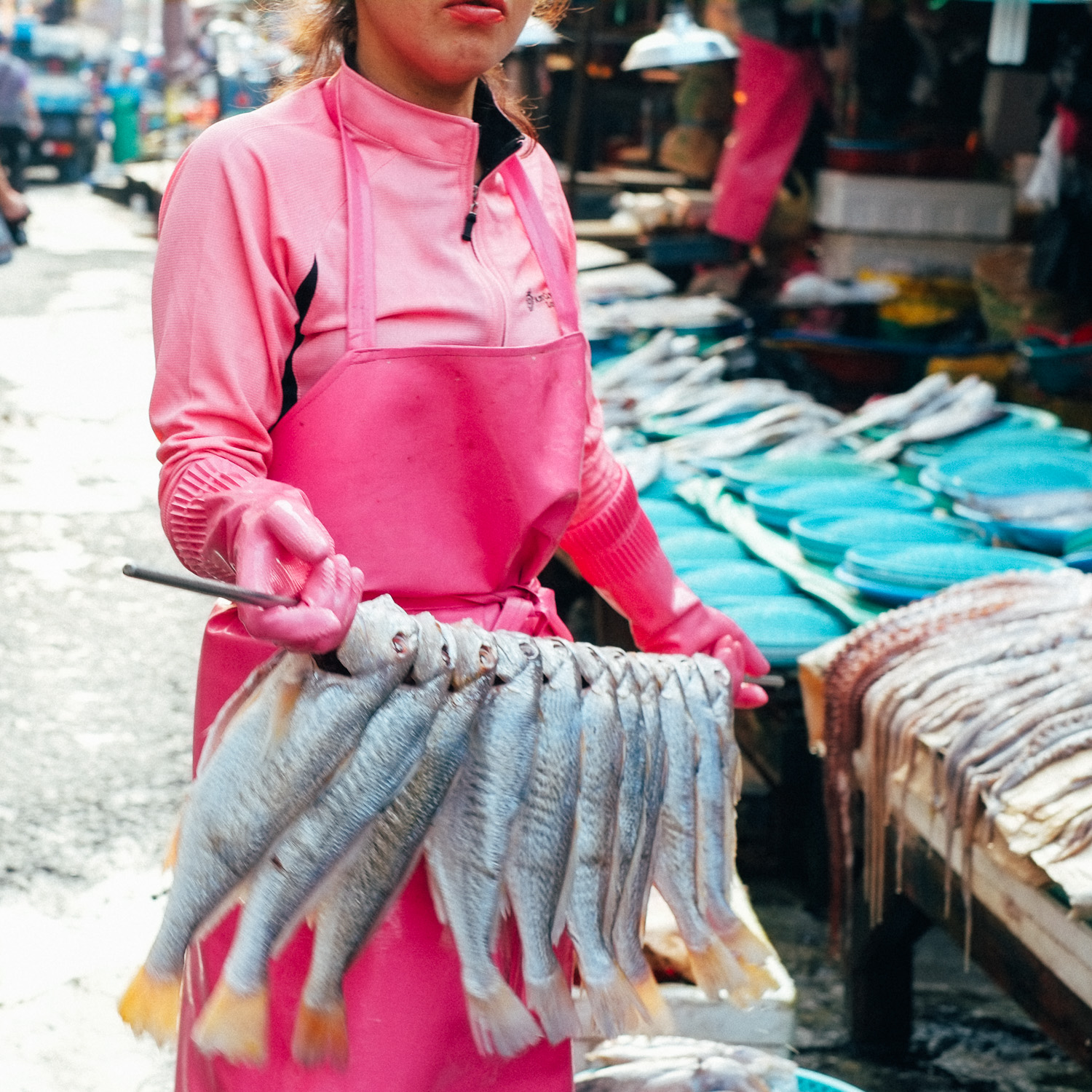 Carina Sze Lau travel- Lady in pink at Jagalchi Market, Korea