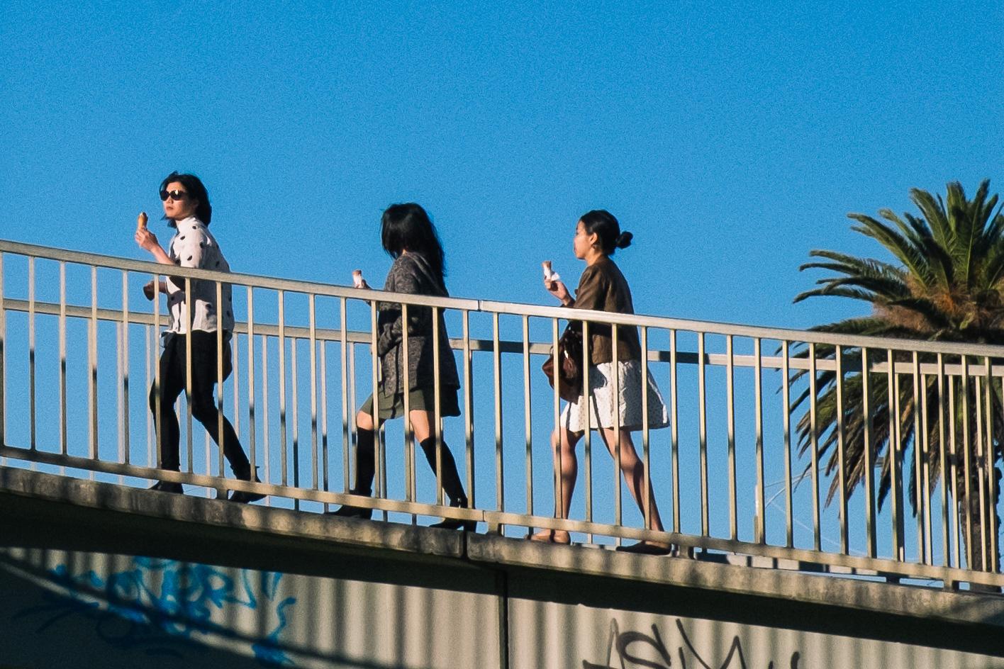 Carina Sze Lau - Life Session - sisters walking across bridge St Kilda Melbourne
