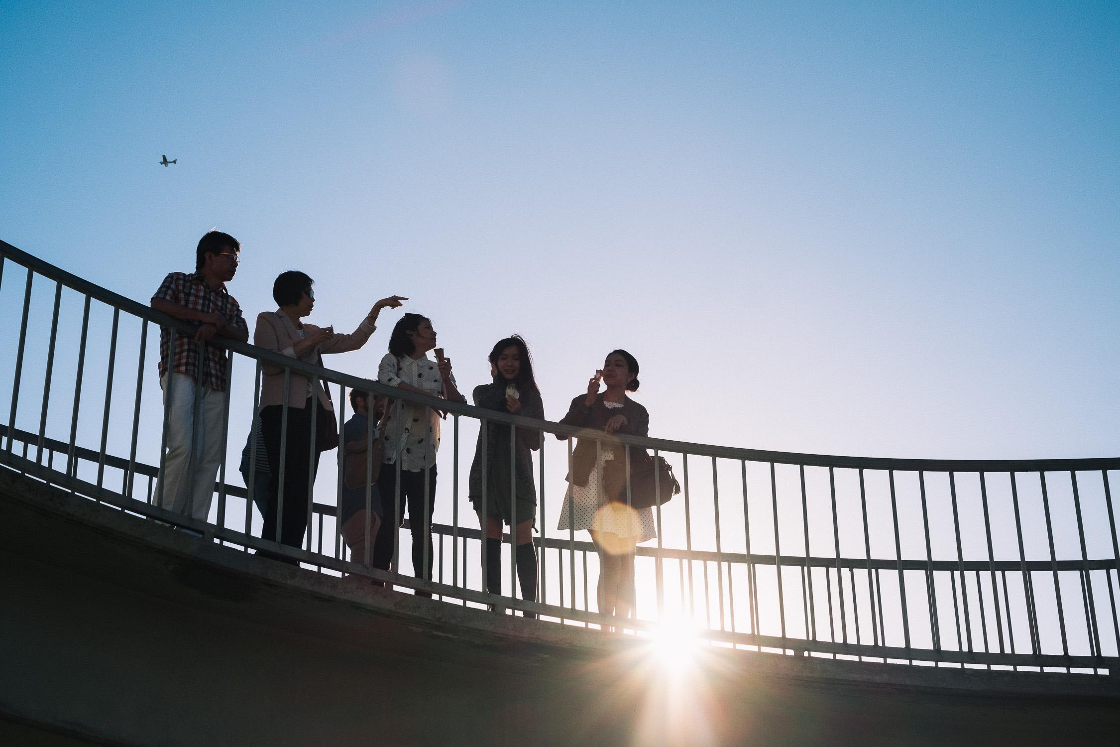 Carina Sze Lau - Life Session - family silhouette on bridge in St Kilda Melbourne