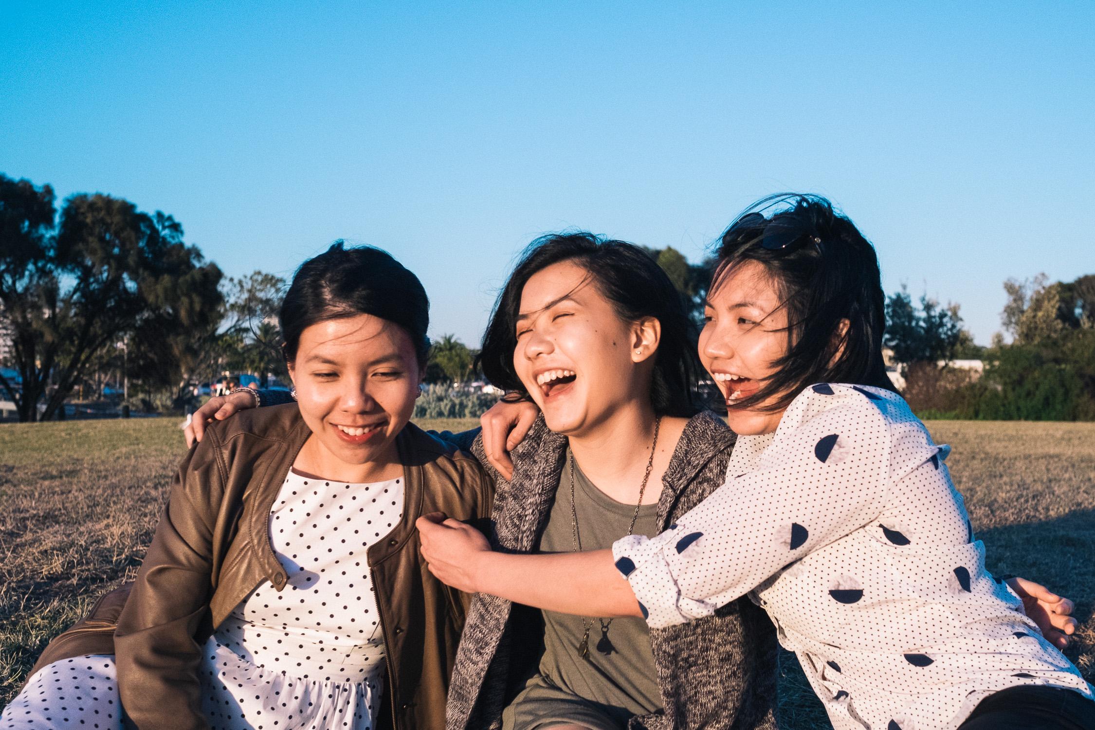 Carina Sze Lau - Life Session - sisters laughing in St Kilda Melbourne