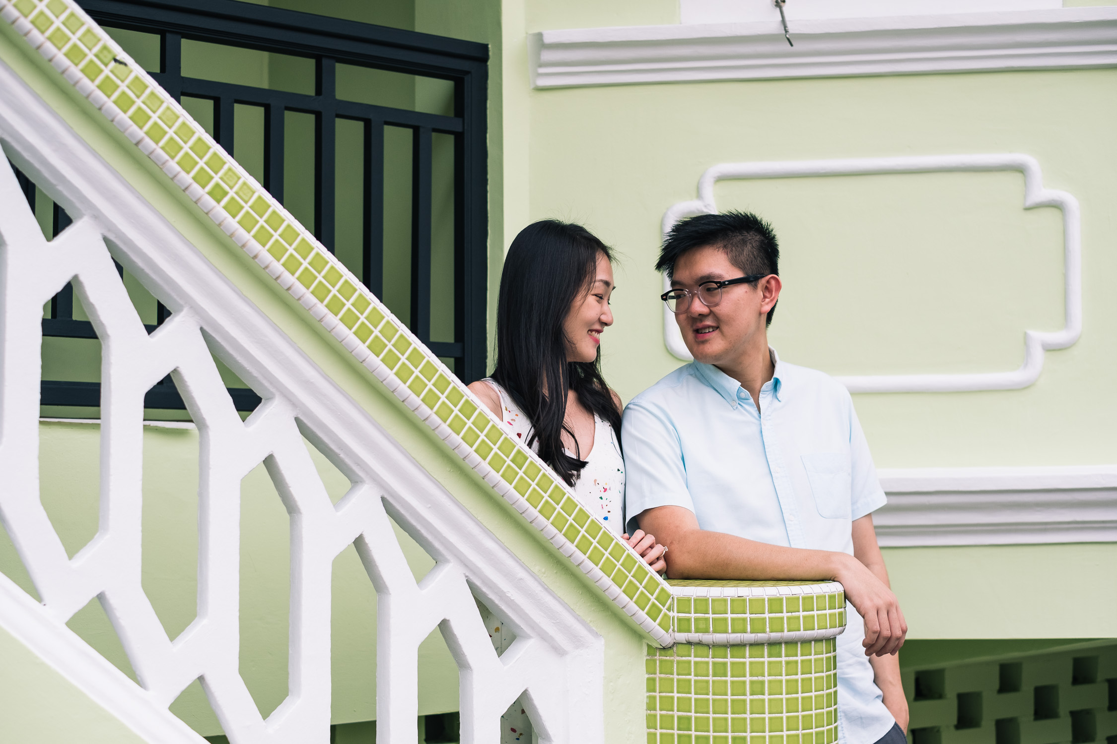 Engaged couple with green traditional house, Singapore prewedding shoot