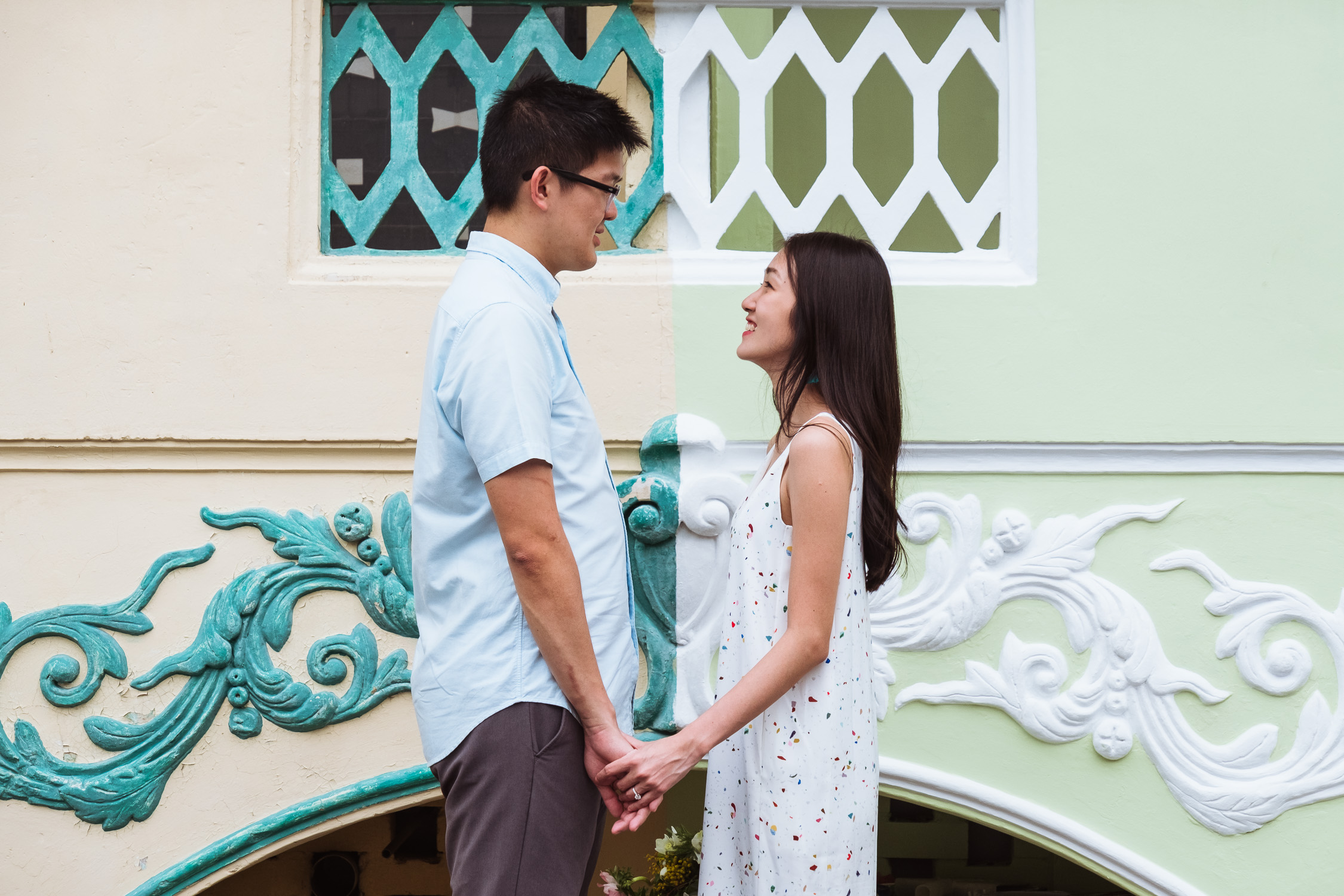 Engaged couple with colourful traditional house, Singapore prewedding shoot