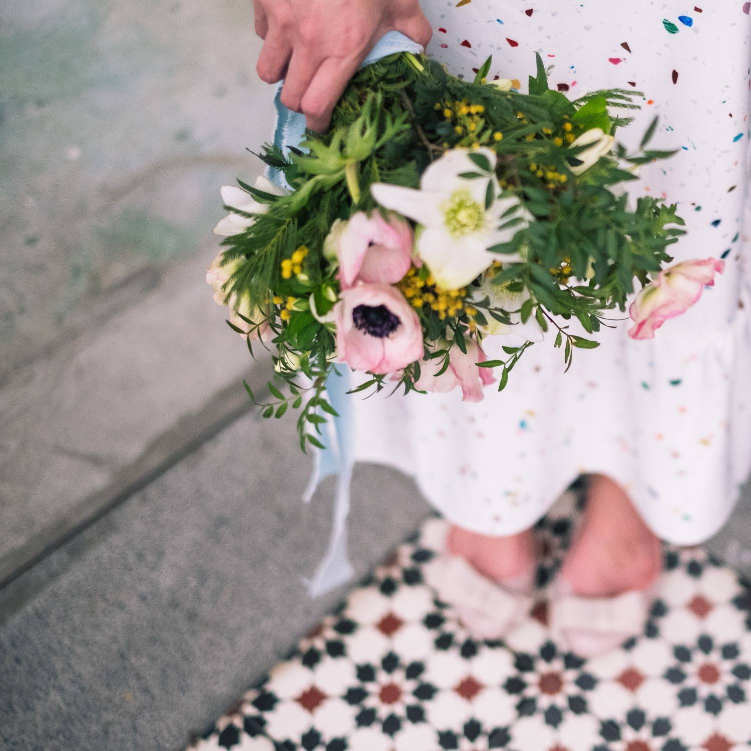 Engagement bouquet and polka dot dress in Singapore prewedding shoot
