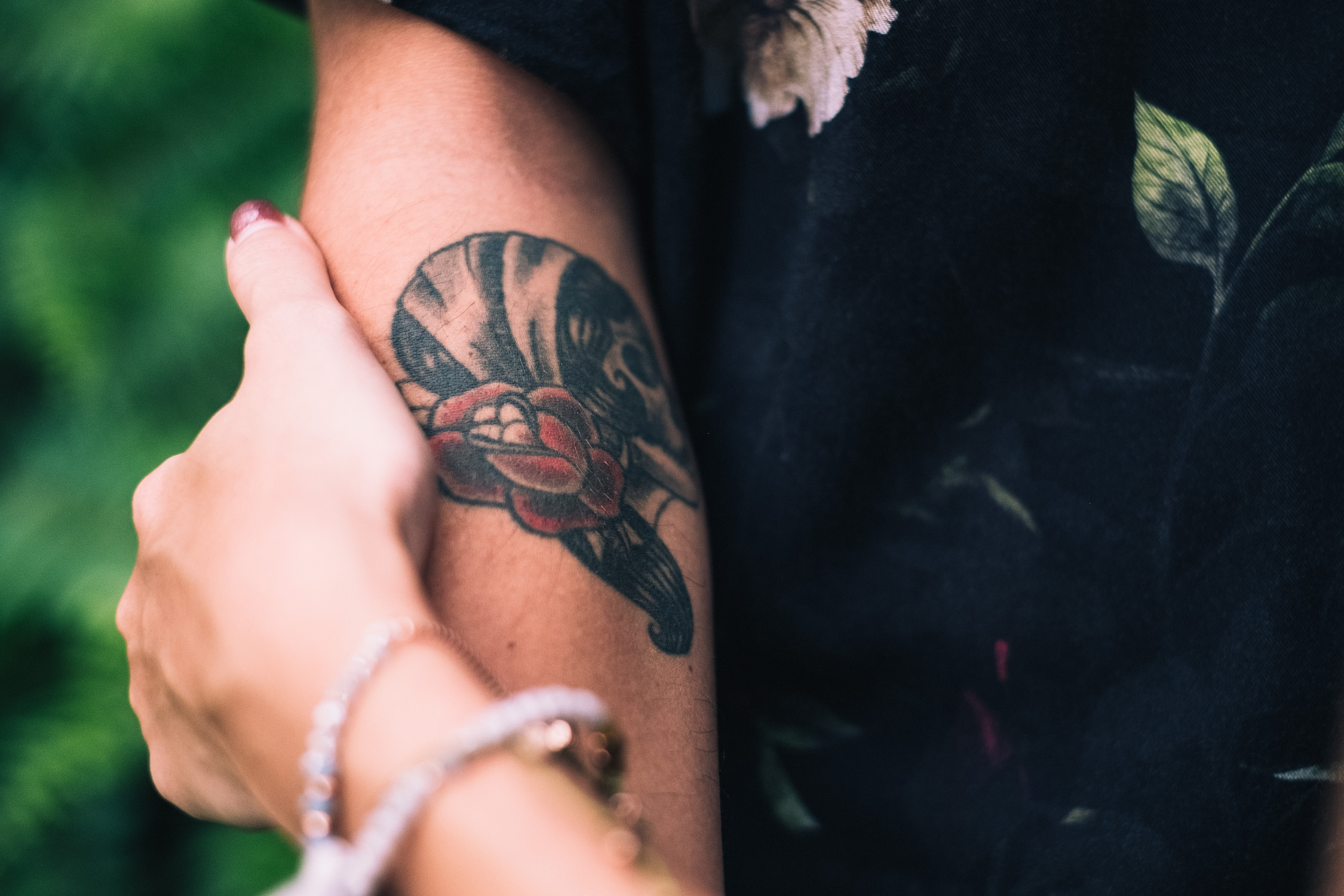 Suwan and Jean Francois from their Singapore prewedding forest shoot - close up of tattoo