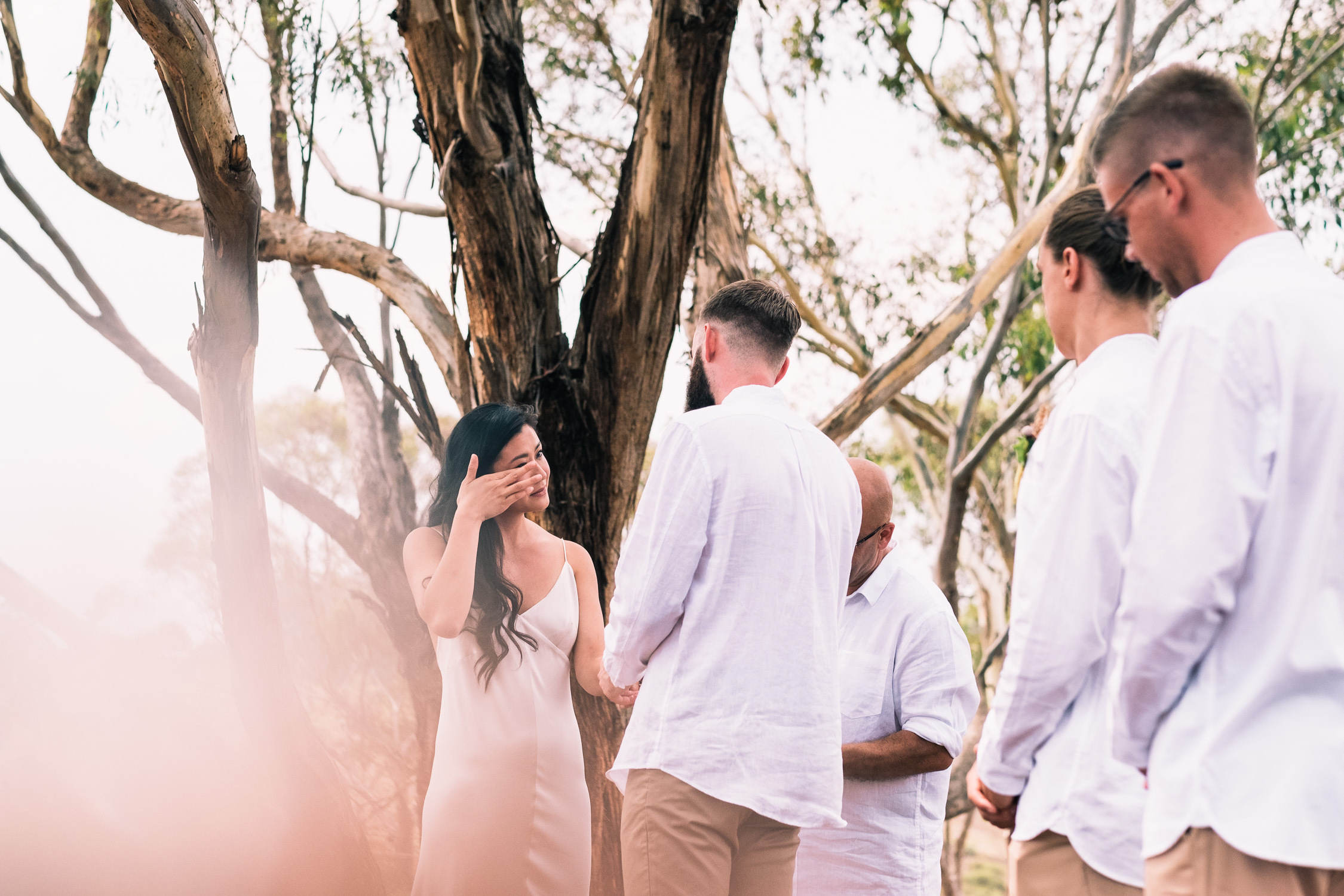 Melbourne Sunnystones Camp Wedding - bride crying during vows at outdoor ceremony